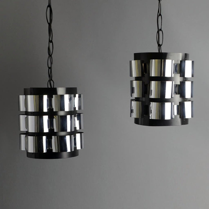 Hanging lamps with aluminum shades in black and brushed aluminum