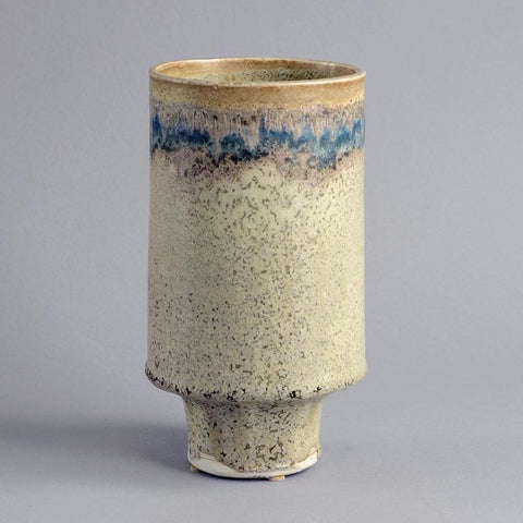 Stoneware vase with matte cream glaze by Derek Davis