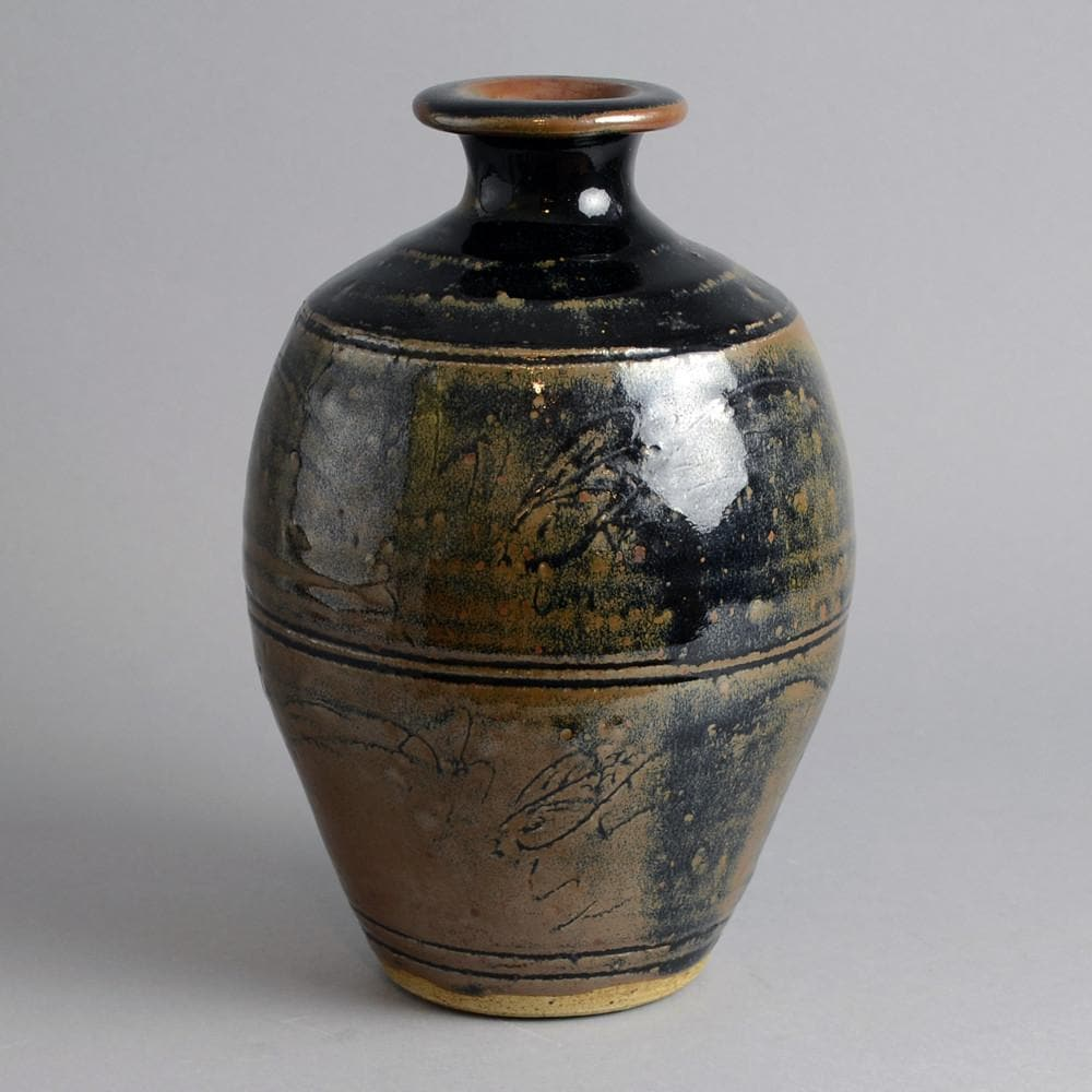 Stoneware vase with glossy black and brown glaze by Jim Malone