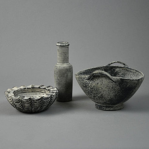Group of items with black and white glaze by Kahler Keramik