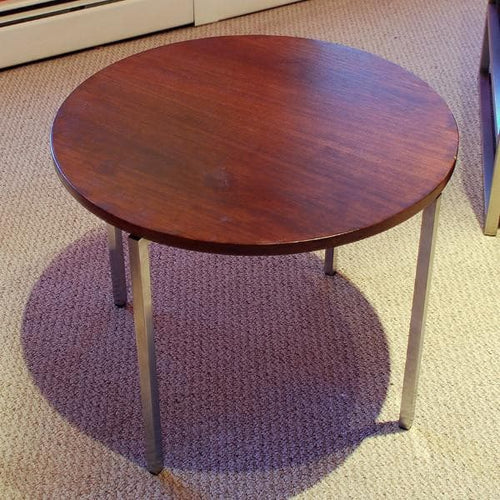 Rosewood table by Florence Knoll