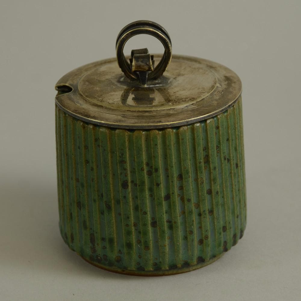 Jar with green glaze and silver lid by Arne Bang