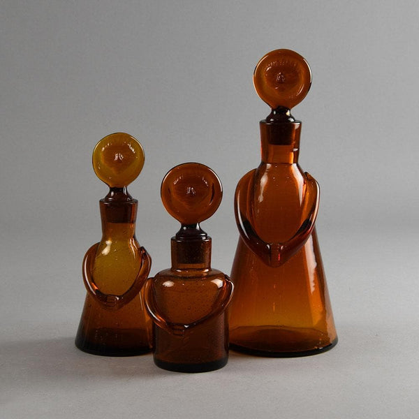Erik Hoglund for Boda Åfors, set of three brown decanters