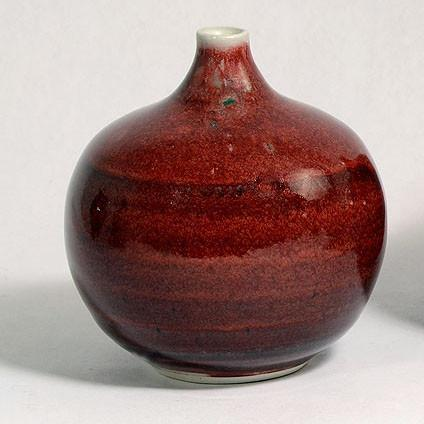 Unique porcelain vase with oxblood glaze by Gerry Williams