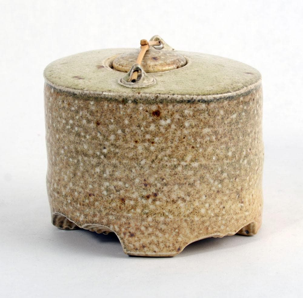 Stoneware jar with lid and wooden bar by Byron Temple