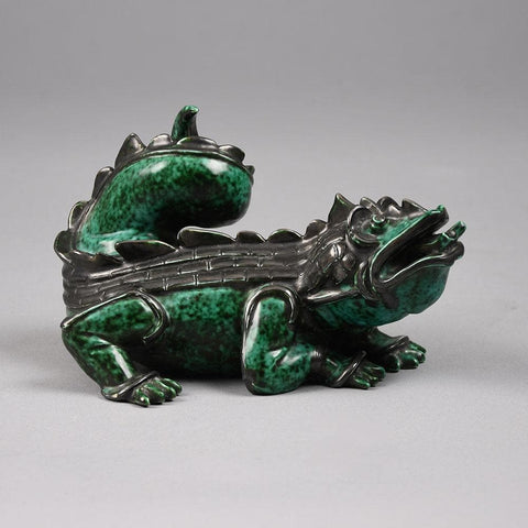 "Wilhelm Kåge for Gustavsberg, ""Dragon Whelp"" figure with green and black glaze"
