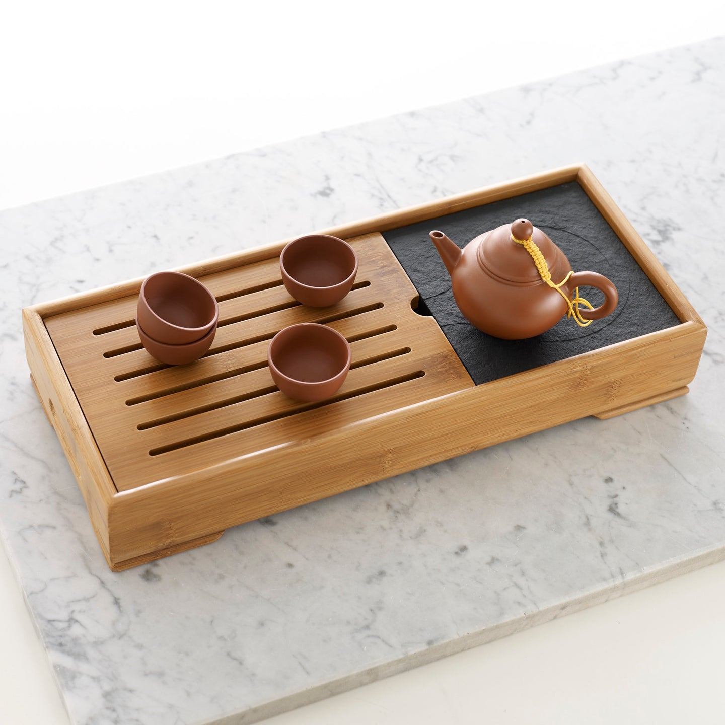 Large bamboo tea tray and Jixing Shui Ping tea pot