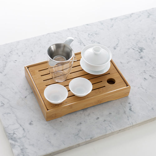 Small bamboo tea tray with Gaiwan tea pot, pitcher and strainer