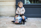 toddler with ride on toy car