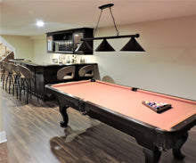 Gorgeous wrap around bar and billiard table.