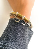 2 OF A KIND: horseshoe bracelet on vintage ticking fabric