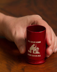 personalized, colored shot glasses in red on hardwood table