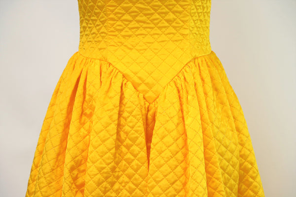 Bold Yellow Quilted Gown with Shoulder Camellia Flower Details