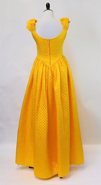 Yellow Brick Road: Bold Yellow Quilted Gown with Shoulder Camellia Flower Details