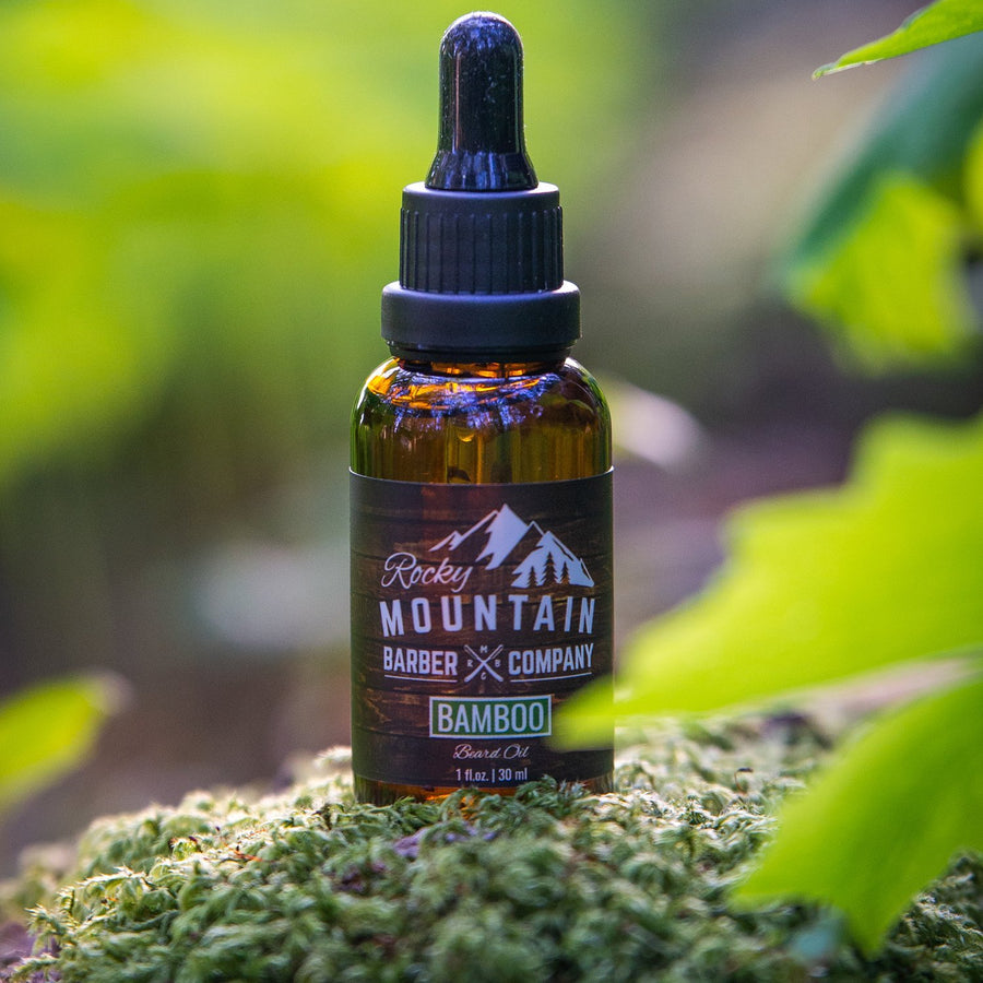 Rocky Mountain Barber Company Bamboo Beard Oil Outdoors in Nature on Wood with Moss