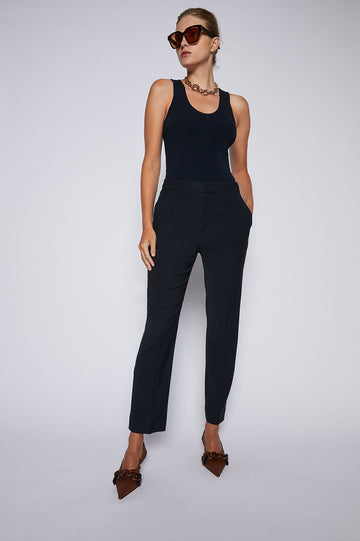 The Atelier Slim Cropped Trouser is a cropped pant with a welt and a flap back pocket