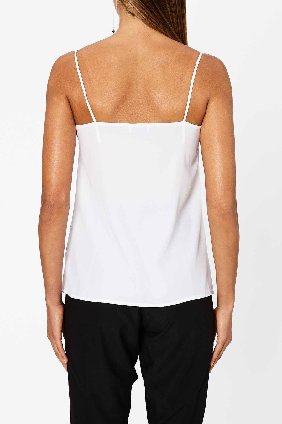 The Shoestring Camisole has a loose fit and features a v-neckline and shoestring shoulder straps