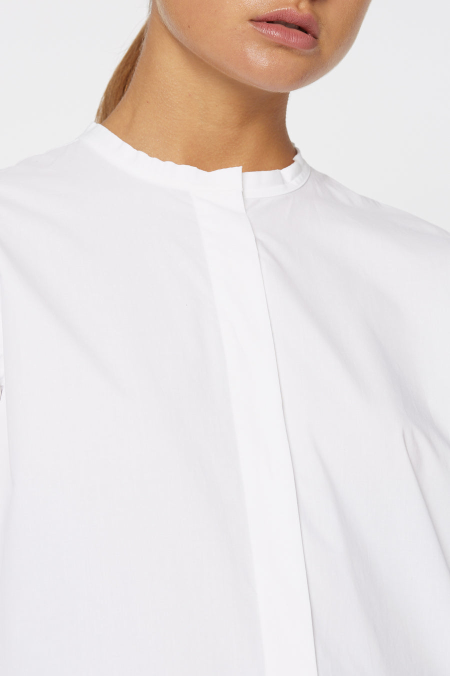 CUT EDGE GRANDPA SHIRT, oversized tailored shirt, button down, round collarless neckline. Color White