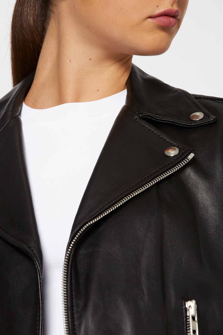 Leather Biker, slim fit, silver hardware, angled centre front zip, two front zip enclosed pockets, 100% Lamb Leather, Color Black