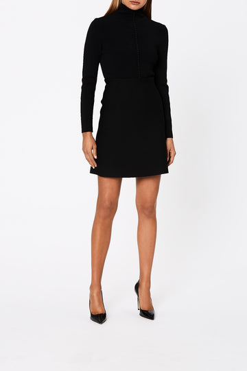 The Crepe Knit A-Line Skirt is fitted at the waist, has an A-line body and sits above the knee