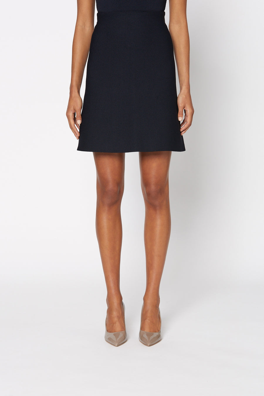 Crepe Knit A-Line Skirt is fitted at the waist, has an A-line body and sits above the knee, color Navy