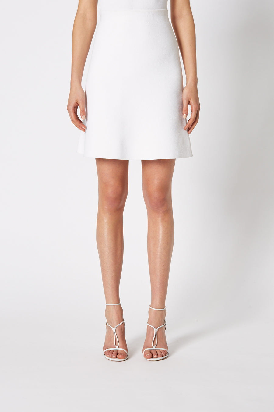 The Crepe Knit A-Line Skirt is fitted at the waist, has an A-line body and sits above the knee.
