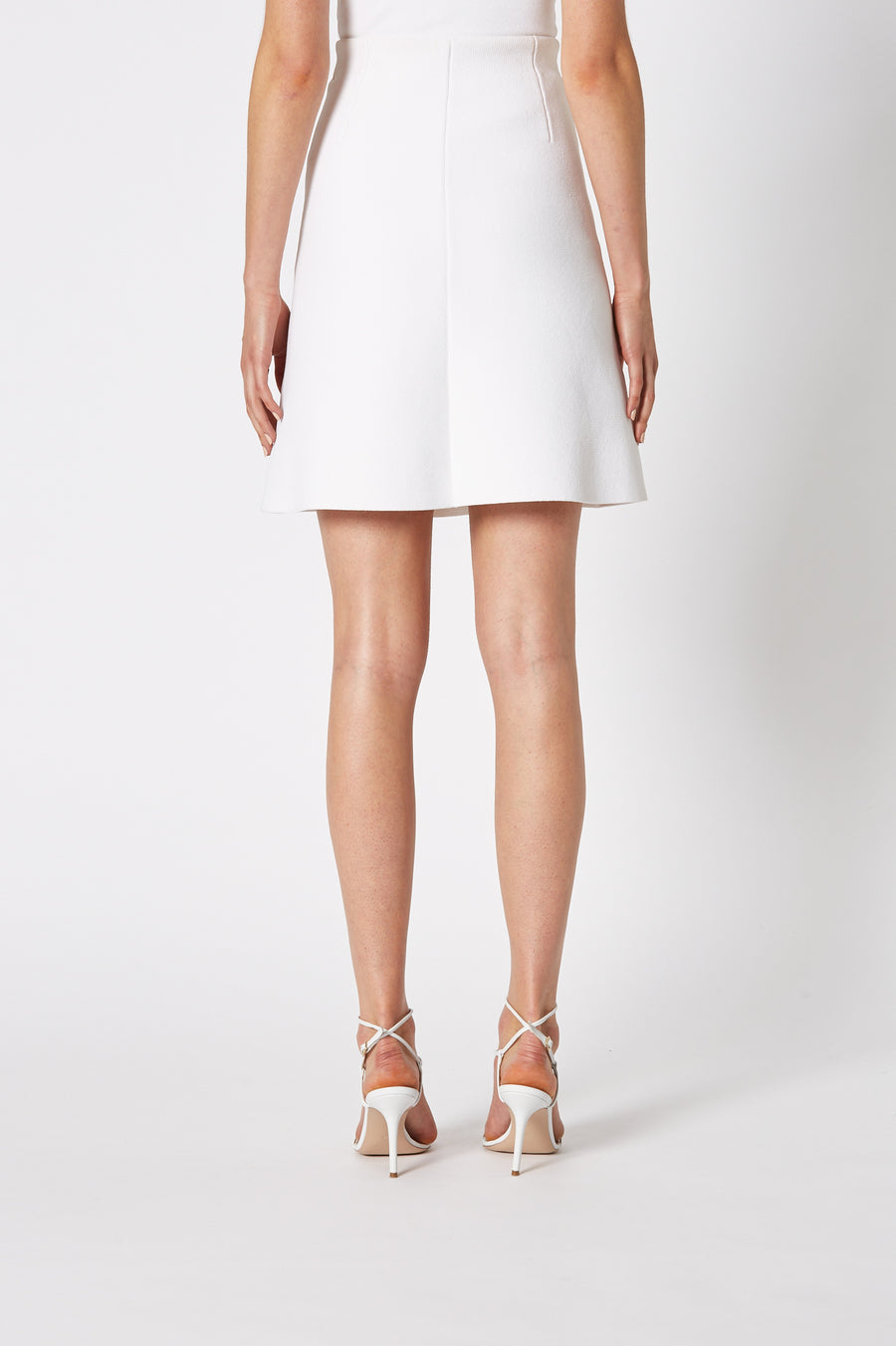 Crepe Knit A-Line Skirt is fitted at the waist, has an A-line body and sits above the knee, color white
