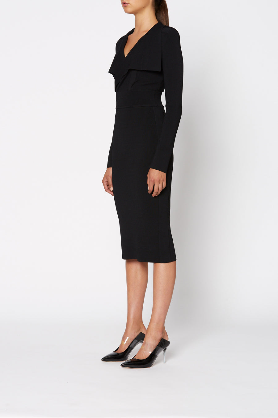 Crepe Knit Drape Front Dress, pointed collar, fitted bodice, shoulder pads, long sleeves, falls below the knee, color black.