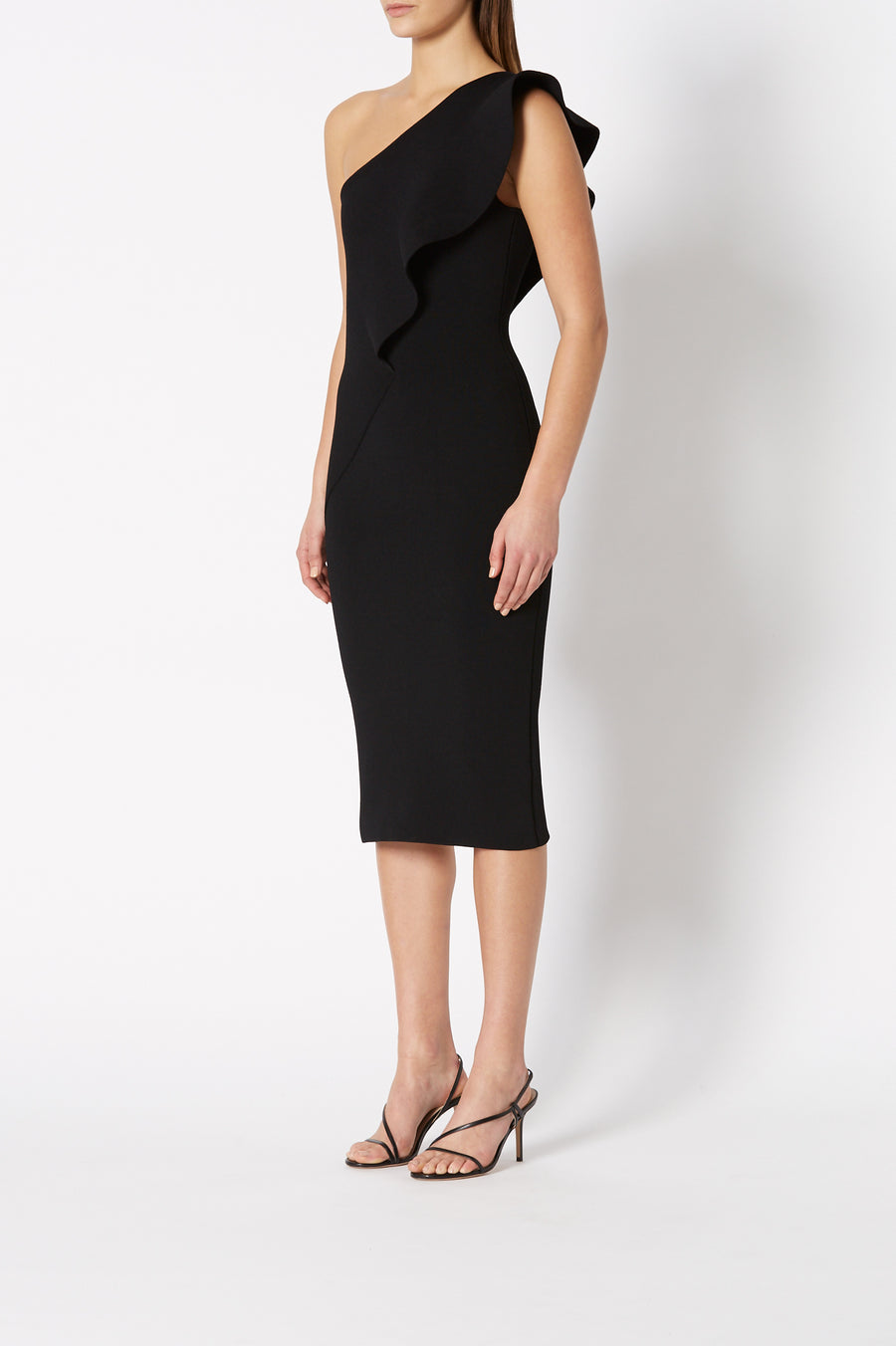The Crepe Knit Ruffle Dress is a one-shoulder dress, fitted throughout
