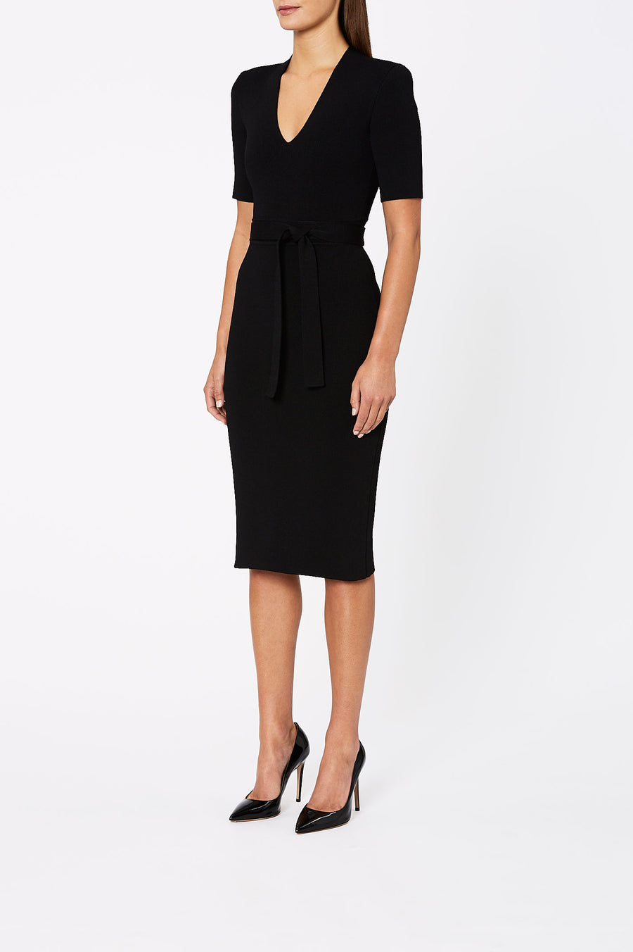 The Crepe Knit V Neck Dress has a fitted silhouette, waist seam belt, mid-length sleeve