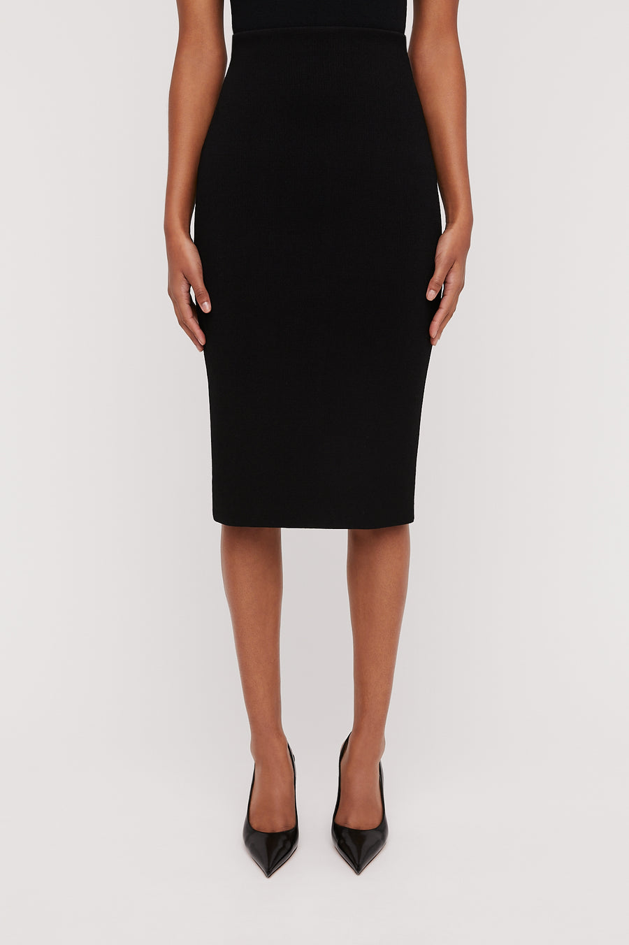 Crepe Knit Slit Back Skirt, Tailored Form Fitting Pencil Skirt. Center Back Split. Color Black