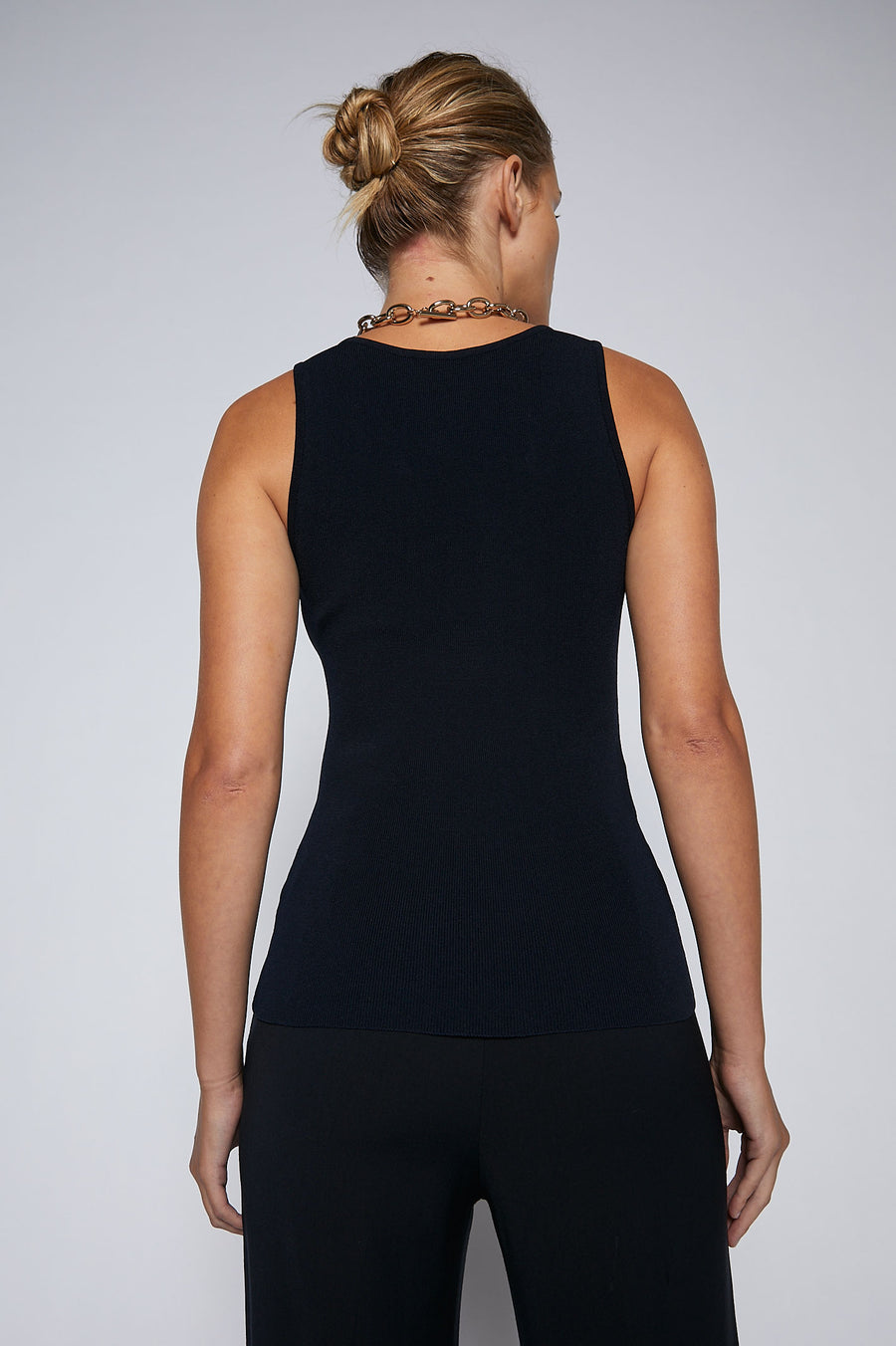 The Crepe Knit Cropped Singlet has a round scoop neckline, medium shoulder straps