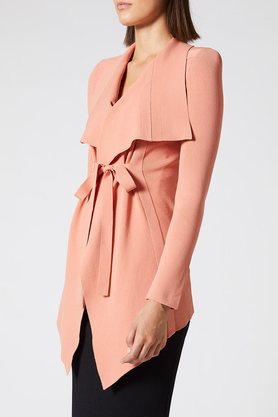 The Crepe Knit Drape Front Jacket is our signature piece.