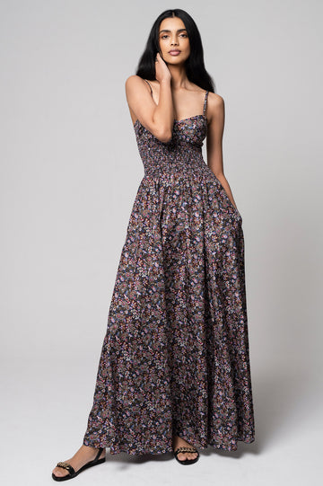 The Floral Shirred Dress has a vibrant paisley print. It features a shirred bodice