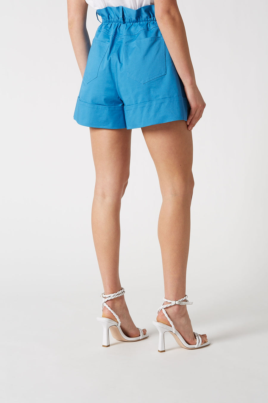 Cut from turchese cotton, the shorts feature a flattering paper bag waist and cuffed hem, sitting at a comfortable mid-thigh length.