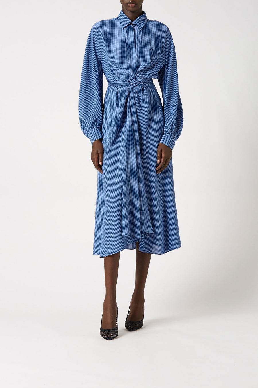 Designed with a flattering wrap style and contemporary blouson sleeves, the mid length dress features a front button closure and narrow collar.