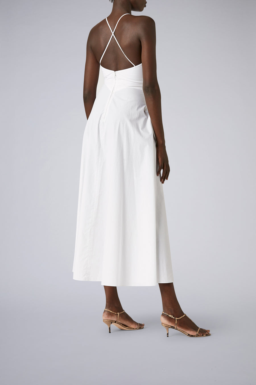 Constructed from a cotton blend fabric with a flattering V-neckline and feminine silhouette.