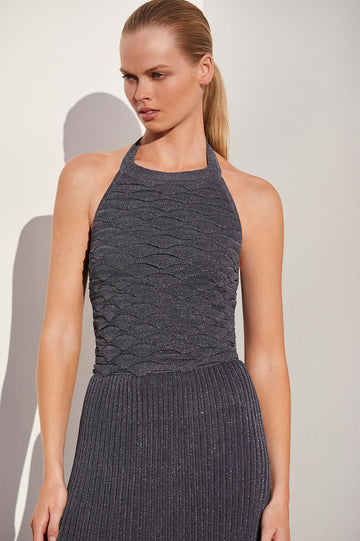 Cut in a stunning halter neckline with an open back, the form fitting top is woven with fine tinsel for subtle detail and shimmer.