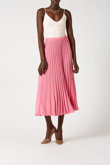 Arriving at an elegant cocktail length, the skirt has a draw cord waist for added femininity and shape.