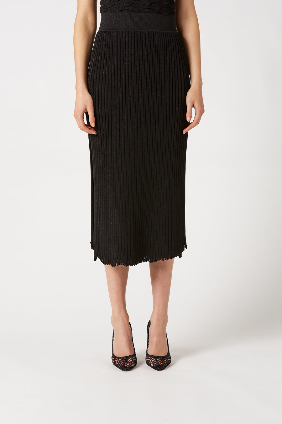 Arriving at an elegant cocktail length, the skirt features side wrap detailing and back zip closure.