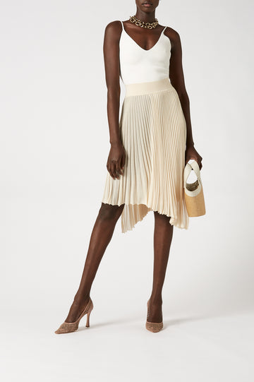 Crafted from a fine knit, the skirt falls to an elegant asymmetrical hem and below the knee length.