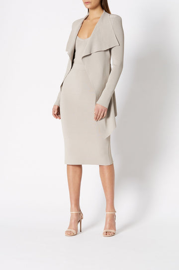 The Crepe Knit Slit Back Skirt is a tailored skirt.