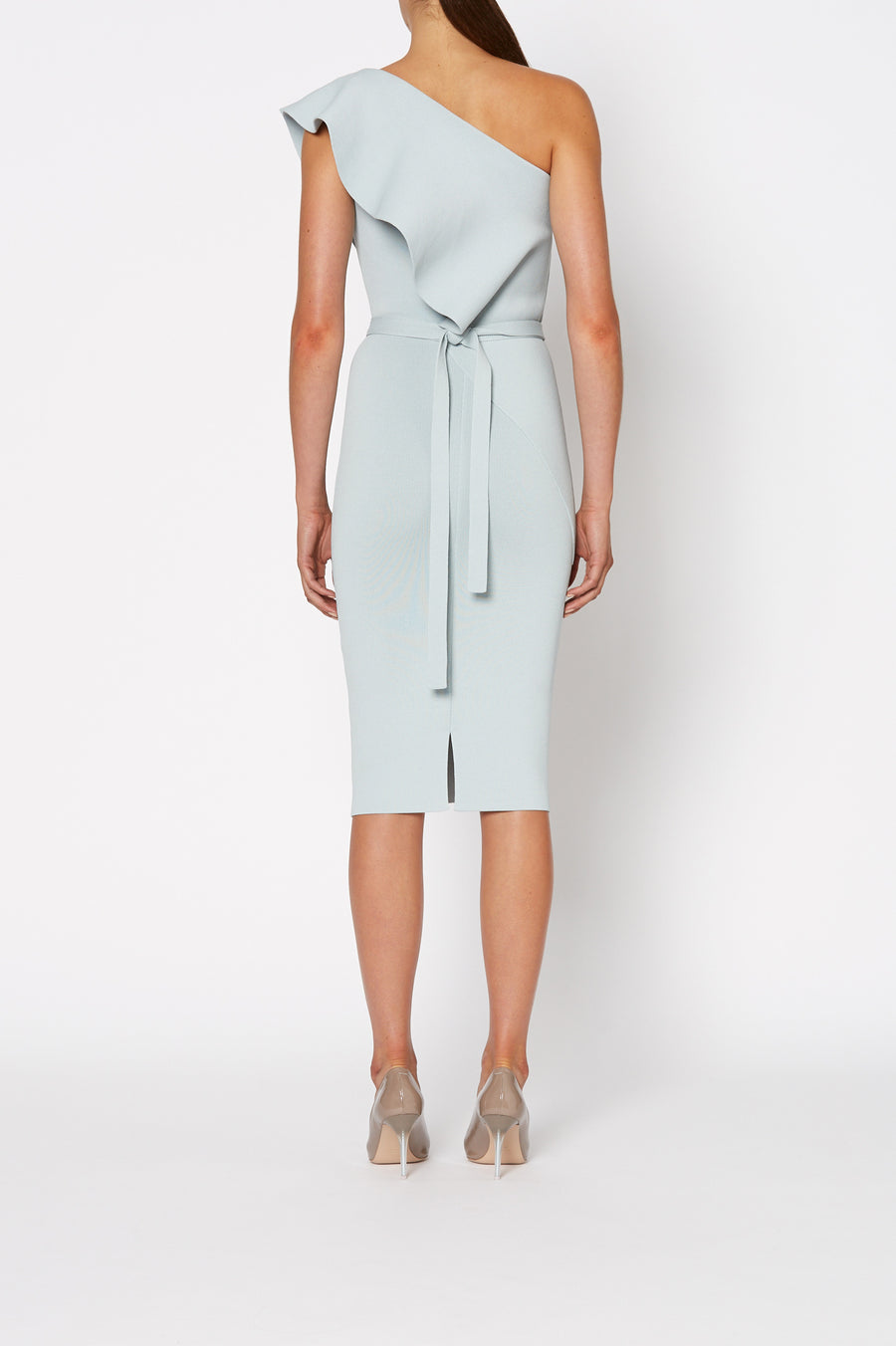 Crepe Knit Ruffle Dress, one shoulder dress, fitted throughout, ruffle feature from shoulder through opposite hip, falls just below knee, skirt has center back slit, Separate belt in same fabric included, Color Argento