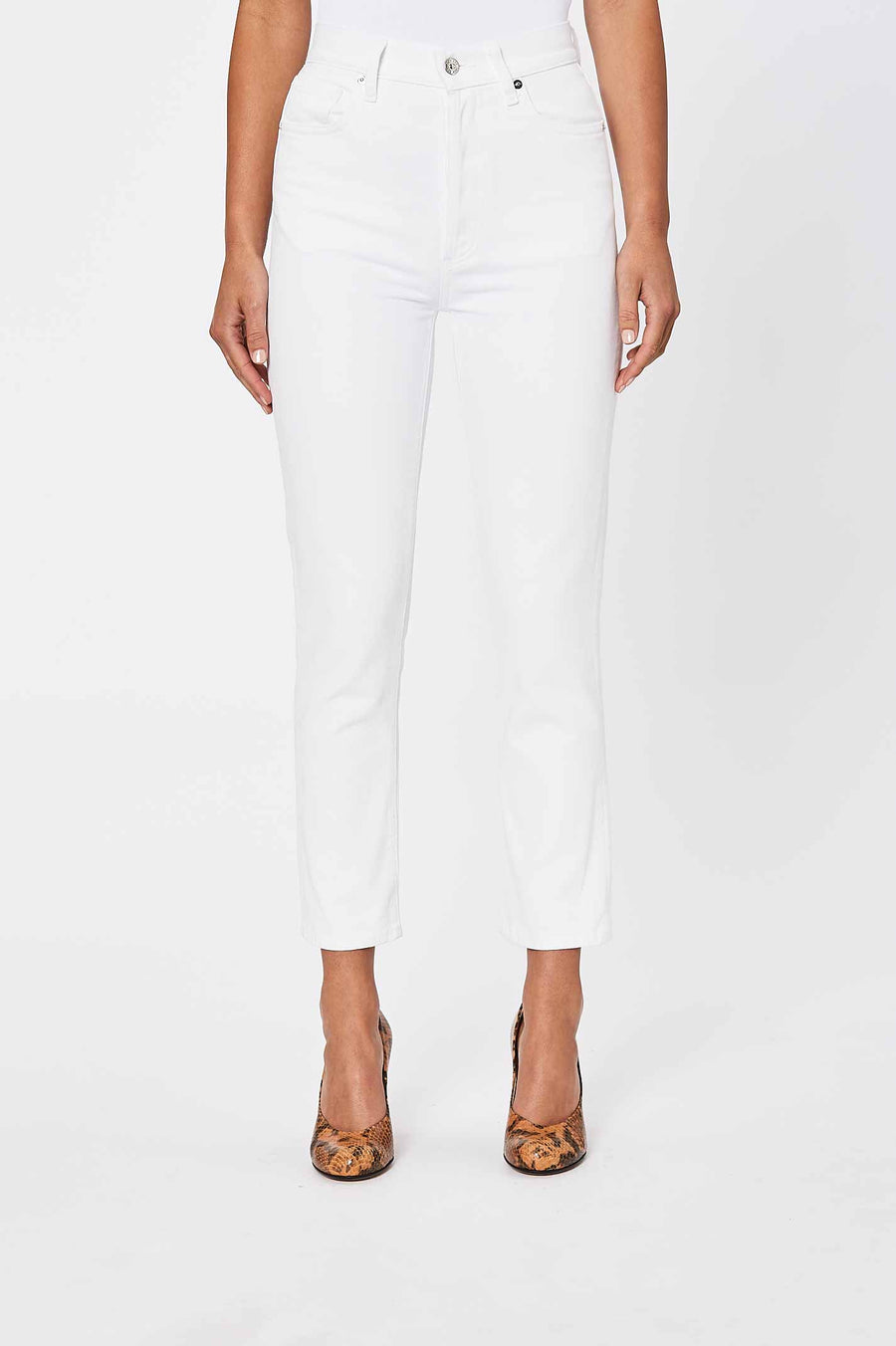 Straight leg jeans, cut high to create just enough room at the hips and thighs.