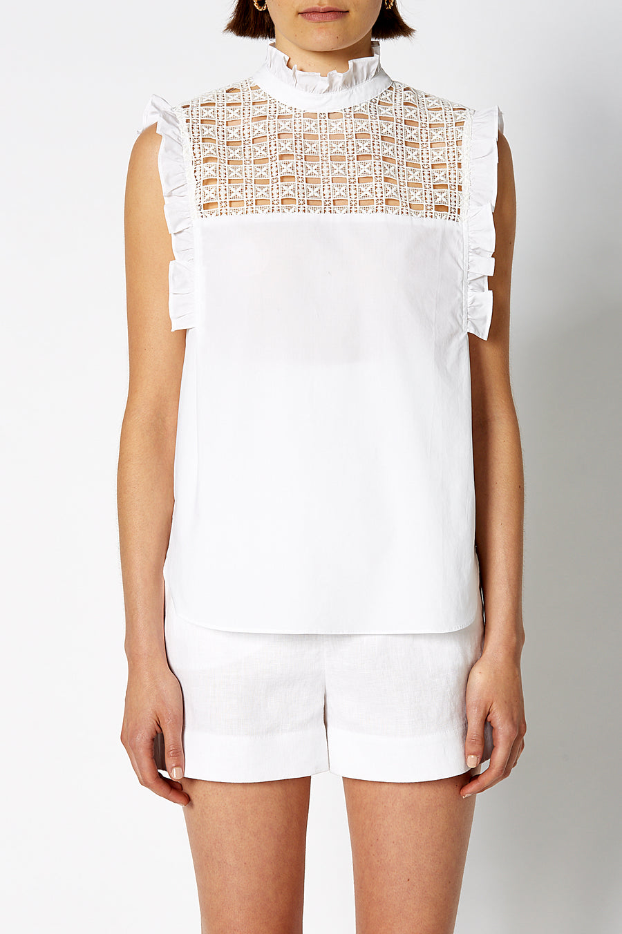 Lace Trim Sleeveless Shirt White, high neckline, neck and shoulder ruffle detail, embroidered panel