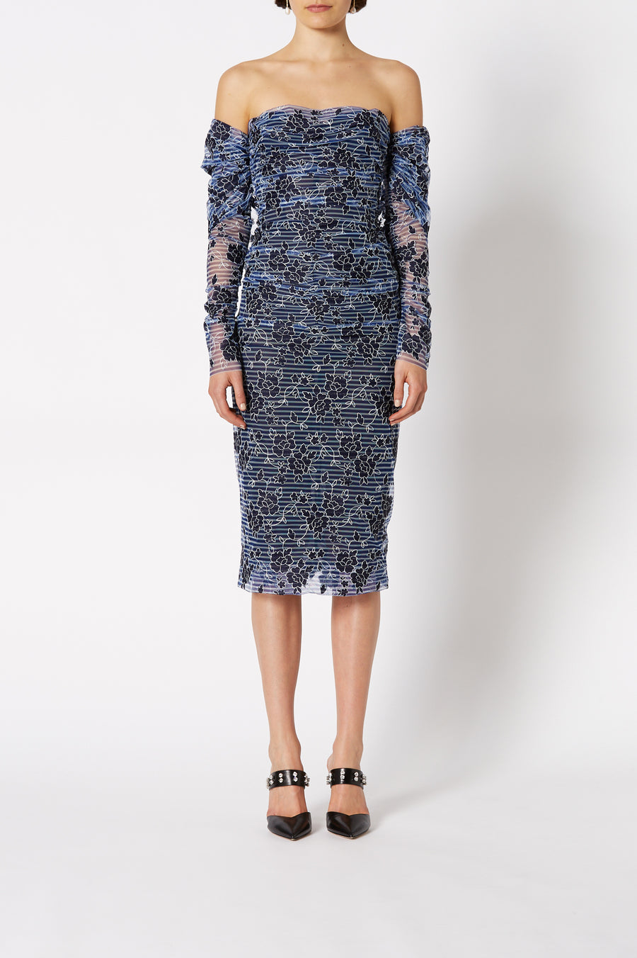 The Embroidered Tulle Dress in Navy is designed for a slim fit and midi in length, color navy
