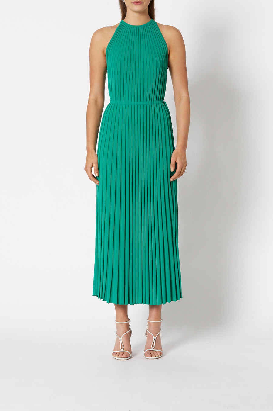 Pleated Rib Halter Gown is a halter dress with a tie closure at the back. The dress cinches in at the waist, color verde