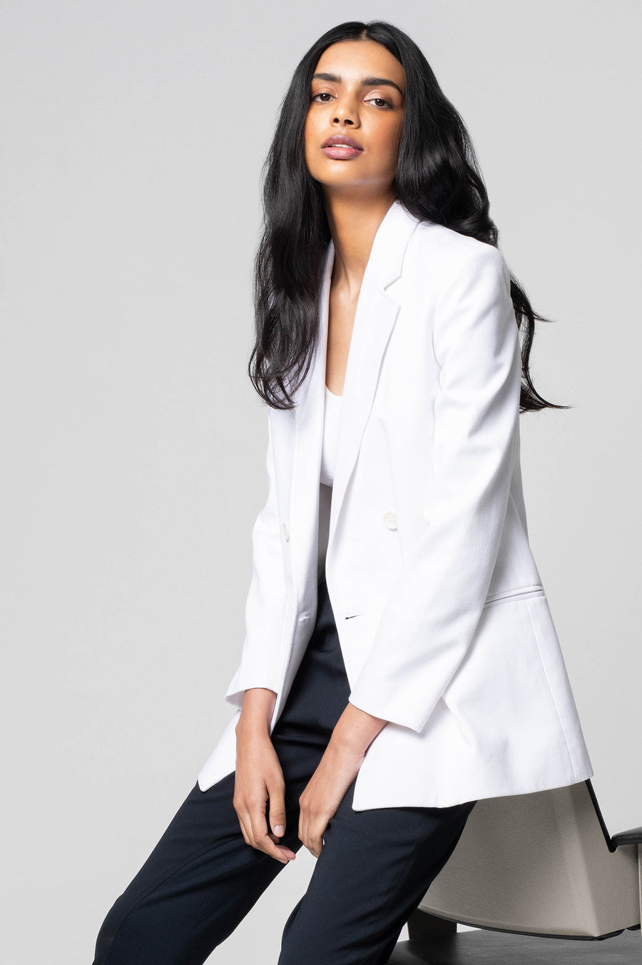The White Sailor Jacket features padded shoulders, double-breasted lapels, and a square-shape loose fit.