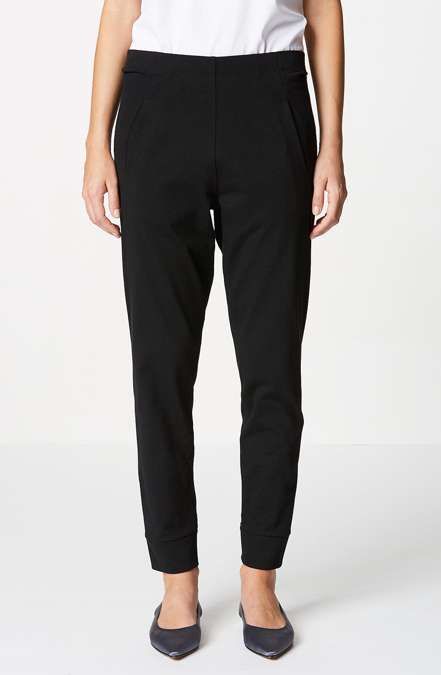 Low Rise Sweat Pant, slim dropped crotch, slanted front pockets, a back jet pocket and tapered leg, color black