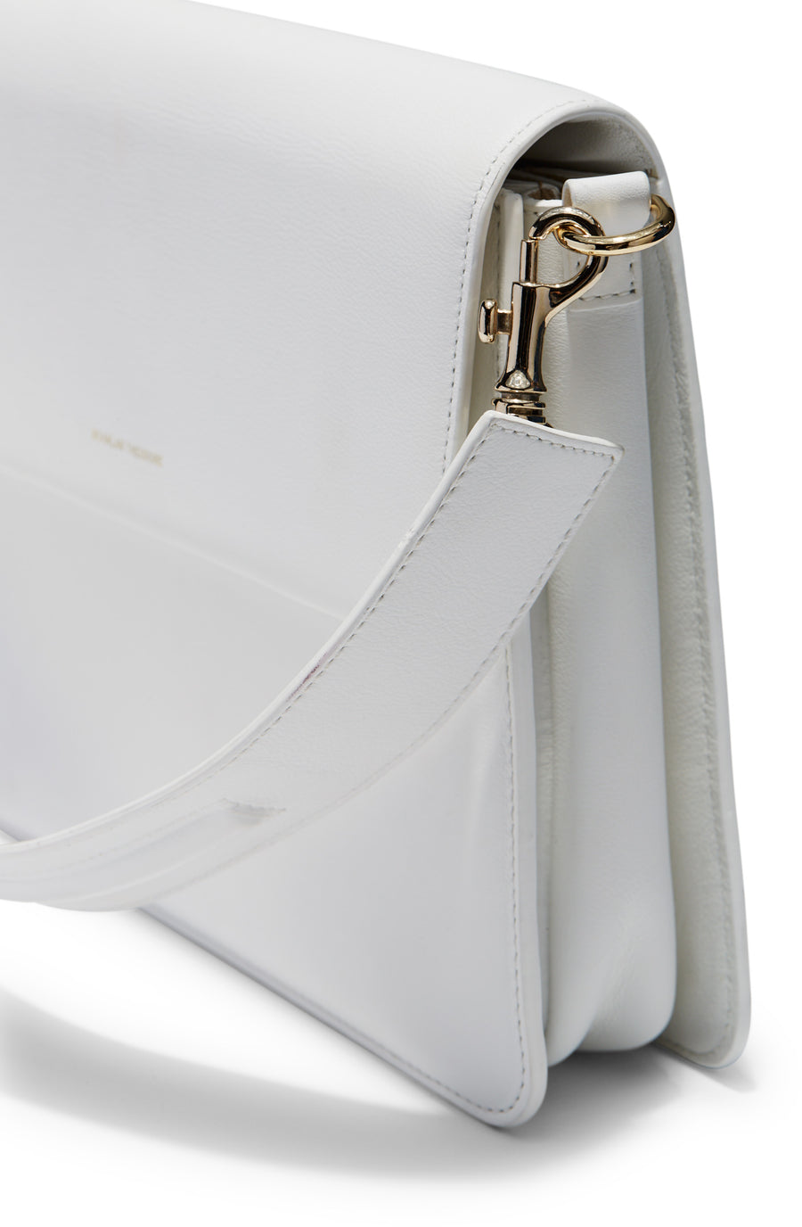 Mirra Bag includes short and long interchangeable leather strap, magnetic closure, suede lining, three internal compartments, one zip internal pocket, gold embossed logo, color bianco